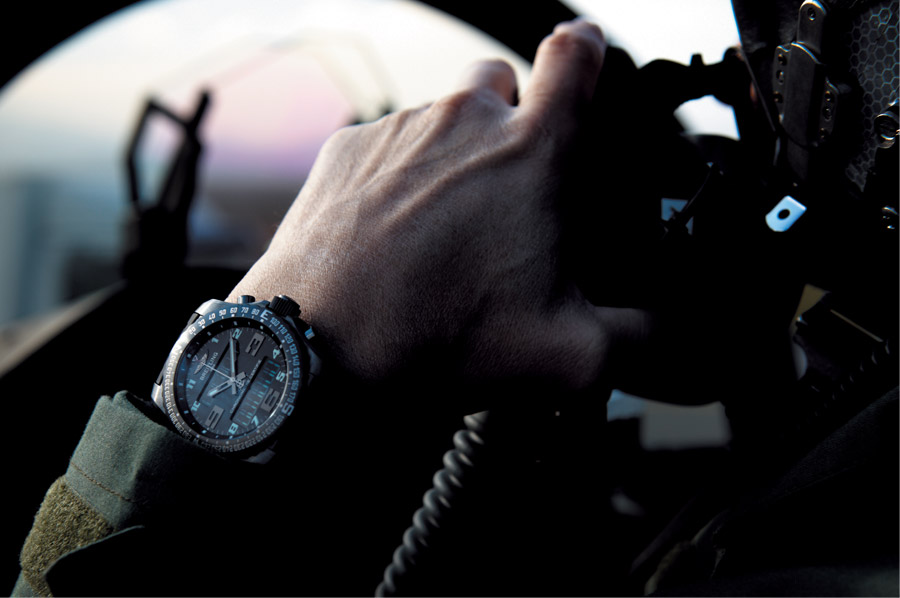 Pilot in jet wearing a Breitling watch